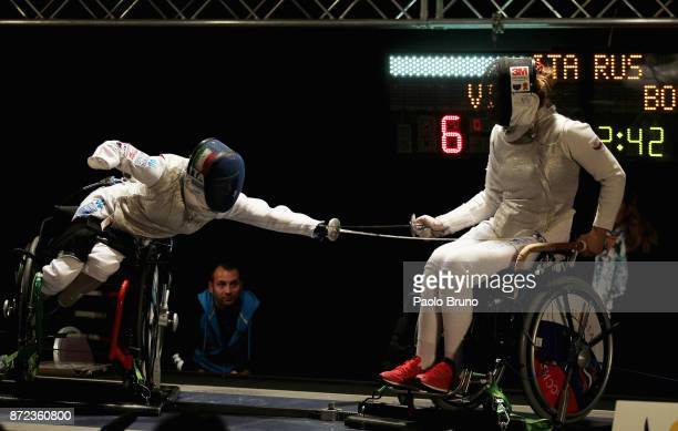 Beatrice Vio of Italy competes with Victoria Boykova of Russia in the Women's Final match foil fencing during the IWAS Wheelchair Fencing World...