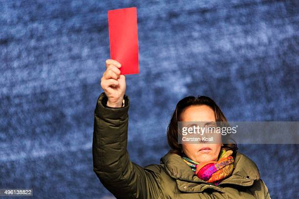 Beatrix von Storch member of the European Parliament of the Alternative fuer Deutschland political party holds a red card as a symbol for their...