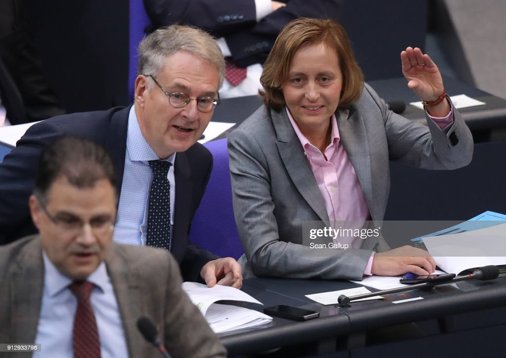 Beatrix von Storch (R) of the right-wing AfD mocks German Greens party member Katrin Goering-Eckardt at the Bundestag during debates over a proposal concerning the rights of refugees who have been granted limited asylum in Germany to bring into Germany members of their immediate families on February 1, 2018 in Berlin, Germany. The German Christian Democrats (CDU/CSU) and the German Social Democrats (SPD), in their ongoing coalition negotiations, agreed yesterday on a compromise that starting August 1 the number of family members allowed to immigrate will be capped at 1,000 per month.