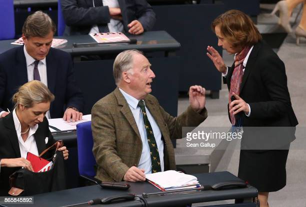 Beatrix von Storch speaks with Alexander Gauland both of the rightwing Alternative for Germany as AfD member Alice Weidel looks on at the conclusion...