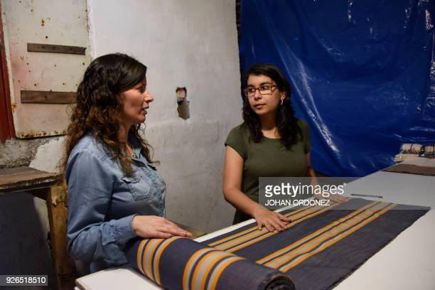 Beatriz Gomez and Alejandra Marroquin prepare a cotton cloth to make bags inspired in Mayan costumes in an attempt to put a curb on the abuse of...