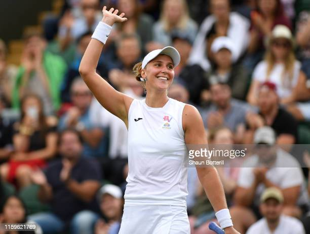 Beatriz Haddad Maia of Brazil celebrates victory in her Ladies' Singles first round match against Garbine Muguruza of Spain during Day two of The...