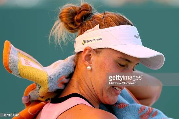 Beatriz Haddad Maia of Brazil cools down between games while playing Jelena Ostapenko of Latvia during the Miami Open Presented by Itau at Crandon...