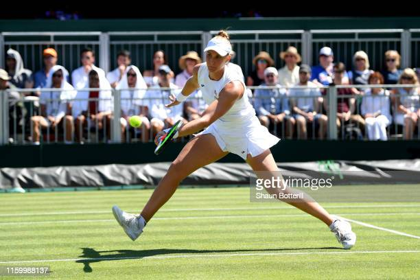 Beatriz Haddad Maia of Brazil in her Ladies' Singles second round match against Harriet Dart of Great Britain during Day four of The Championships...