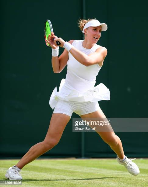 Beatriz Haddad Maia of Brazil plays a backhand in her Ladies' Singles first round match against Garbine Muguruza of Spain during Day two of The...