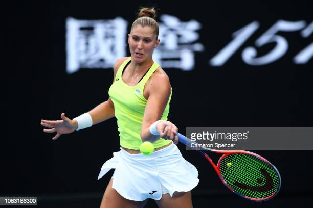 Beatriz Haddad Maia of Brazil plays a forehand in her second round match against Angelique Kerber of Germany during day three of the 2019 Australian...
