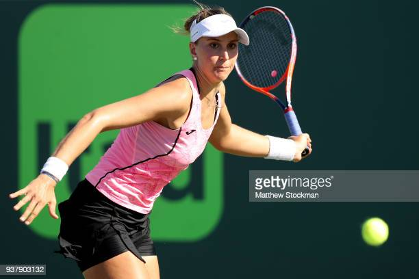 Beatriz Haddad Maia of Brazil returns a shot to Jelena Ostapenko of Latvia during the Miami Open Presented by Itau at Crandon Park Tennis Center on...