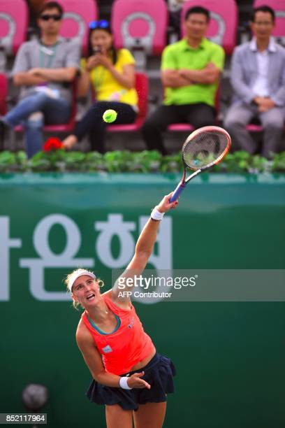 Beatriz Haddad Maia of Brazil serves against Richel Hogenkamp of the Netherlands during their women's singles semifinal match at the WTA Korea Open...