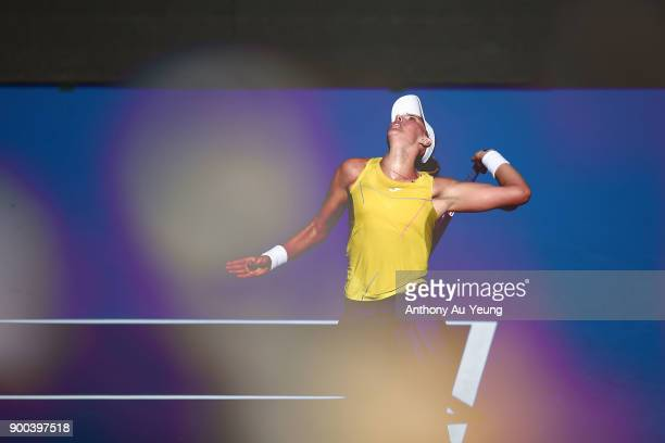Beatriz Haddad Maia of Brazil serves in her first round match against Agnieszka Radwanska of Poland during day two of the ASB Women's Classic at ASB...
