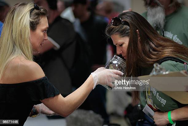 Beatriz HerreraRodden shows off some of her marijuana samples to a woman at the Cannibis Crown 2010 expo April 18 2010 in Aspen Colorado...