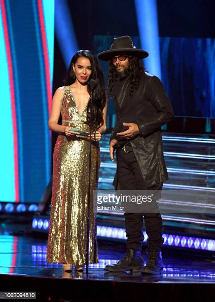 Beatriz Luengo and Draco Rosa present an award onstage during the 19th annual Latin GRAMMY Awards at MGM Grand Garden Arena on November 15 2018 in...