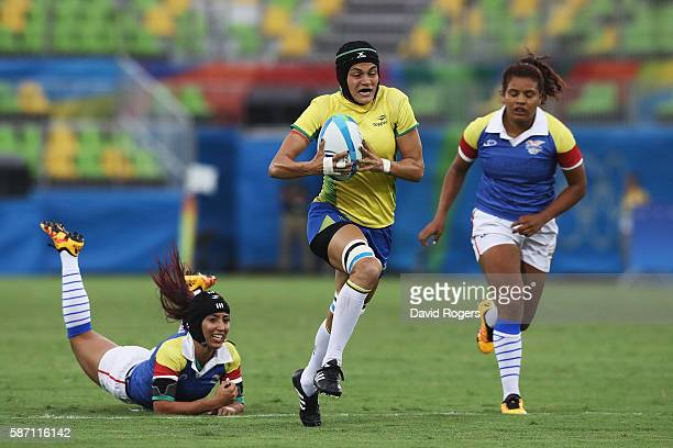 Beatriz Muhlbauer of Brazil carries the ball in to score a try against Colombia during the Women's Placing 9-12 rugby match on Day 2 of the Rio 2016...