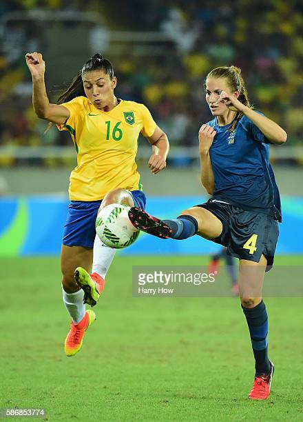 Beatriz of Brazil and Emma Berglund of Sweden compete for the ball during the Women's Group E first round match between Brazil and Sweden on Day 1 of...