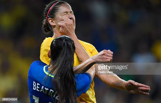 Beatriz of Brazil battles against Laura Alleway of Australia in extra time during the Women's Football Quarterfinal match at Mineirao Stadium on Day...