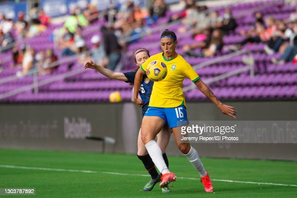 Beatriz of Brazil battles for the ball during a game between Brazil and USWNT at Exploria Stadium on February 21, 2021 in Orlando City, Florida.