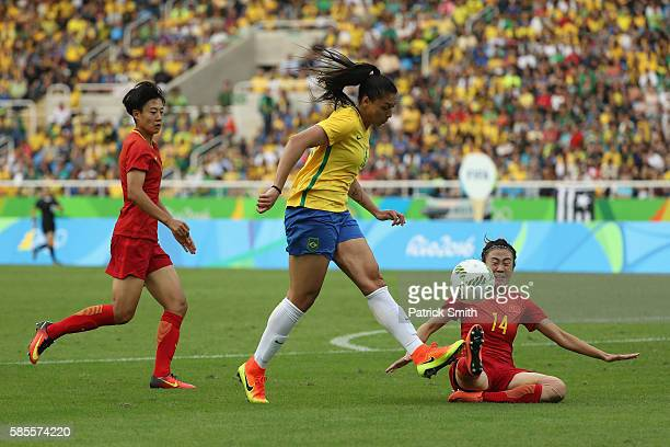 Beatriz of Brazil battles for the ball with Rong Zhao of China during the Women's Group E first round match between Brazil and China PR during the...