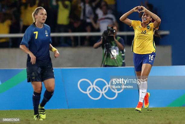 Beatriz of Brazil celebrates after scoring the first goal for Brazil as Lisa Dahlkvist of Sweden looks on during the Women's Group E first round...