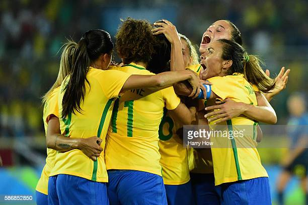 Beatriz of Brazil celebrates her goal with teammates during the Women's Group E first round match between Brazil and Sweden on Day 1 of the Rio 2016...