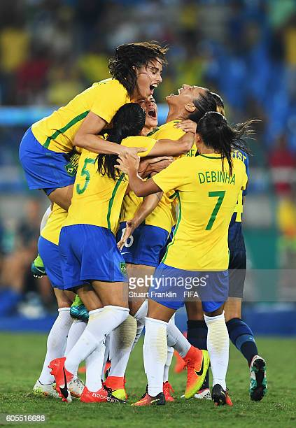 Beatriz of Brazil celebrates scoring her second goal during the Olympic Women's Football match between Brazil and Sweden at Olympic Stadium on August...