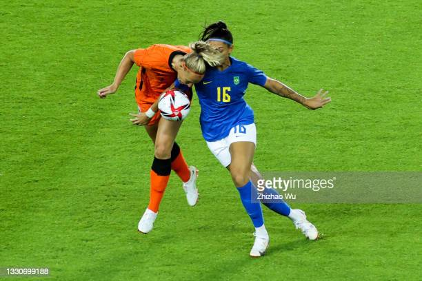 Beatriz of Brazil competes for the ball with Van Der Gragt Stefanie of Netherland during the Women's First Round Group F match on day one of the...
