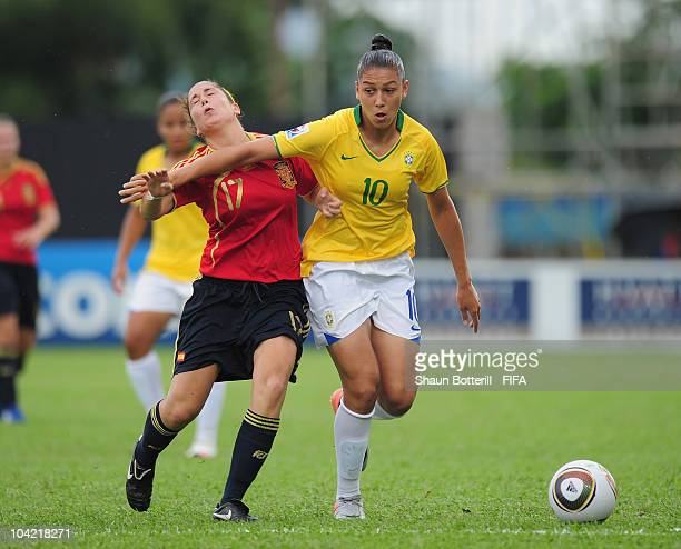 Beatriz of Brazil is challenged by Sara Merida of Spain during the FIFA U17 Women's World Cup Quarter Final match between Spain and Brazil at the Ato...