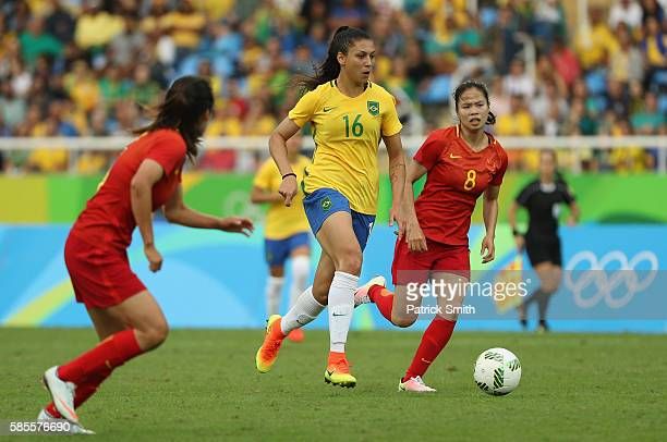 Beatriz of Brazil is chased by Ruyin Tan of China during the Women's Group E first round match between Brazil and China PR during the Rio 2016...