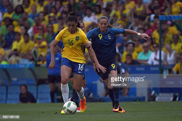 Beatriz of Brazil is checked by Asllani Kosovare of Sweden during the Women's Football Semi Final between Brazil and Sweden on Day 11 of the Rio 2016...