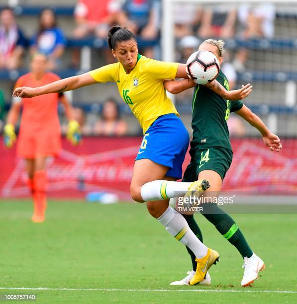 Beatriz of Brazil vies for the ball with Alanna Kennedy of Australia during their Tournament of Nations football match at Children's Mercy Park in...