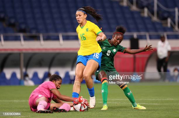 Beatriz of Team Brazil battles for possession with Margaret Belemu of Team Zambia during the Women's Group F match between Brazil and Zambia on day...