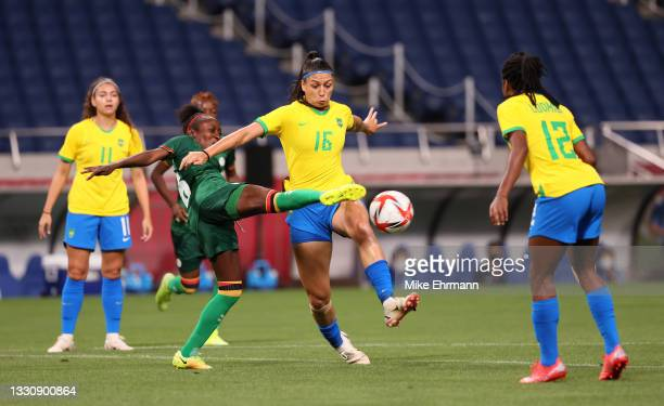Beatriz of Team Brazil is challenged by Margaret Belemu of Team Zambia during the Women's Group F match between Brazil and Zambia on day four of the...