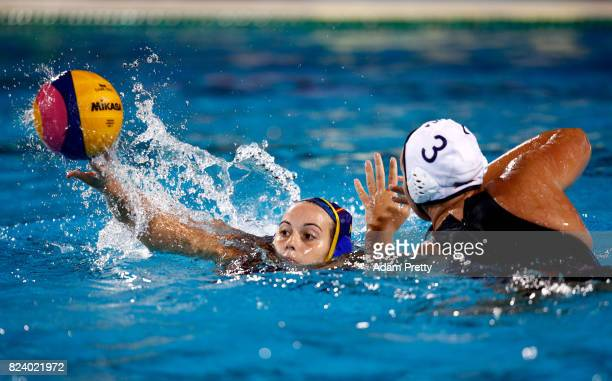 Beatriz Ortiz Munoz of Spain is challenged by Melissa Seidemann of United States during the Women's Water Polo gold medal match between the United...