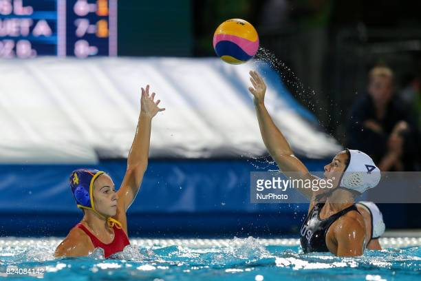 Beatriz Ortiz Munoz of Spain is challenged by Rachel Fattal of United States during the Women's Water Polo gold medal match between the United States...