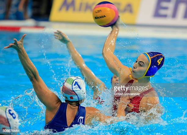 Beatriz Ortiz of Spain in action against Tania Di Maria of Italy during the Women's Preliminary Group B match between Italy and Spain at the...