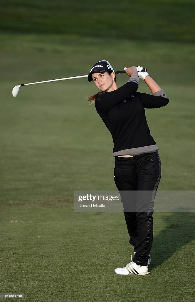 Beatriz Recari of Spain hits her approach shot on the 18th hole in regulation en route to her -9 under par, 2-hole playoff victory over I.K. Kim of South Korea during the Final Round of the LPGA 2013 Kia Classic at the Park Hyatt Aviara Resort on March 24, 2013 in Carlsbad, California.