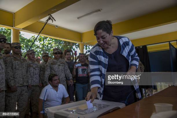 Beatriz Sanchez former presidential candidate for 'Frente Amplio' party casts a ballot during secondround presidential general elections in Santiago...