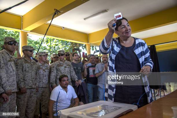 Beatriz Sanchez presidential candidate for the Broad Front party displays a ballot during the second round of presidential general elections in...