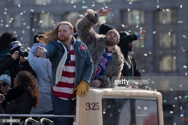 Beau Allen and Chris Long of the Philadelphia Eagles celebrate from the bus during the Super Bowl LII parade on February 8 2018 in Philadelphia...
