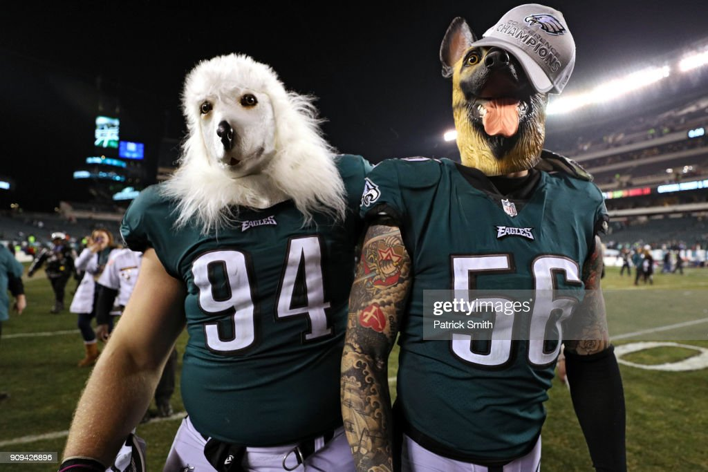 Beau Allen #94 and Chris Long #56 of the Philadelphia Eagles celebrates their teams win while wearing a dog masks over the Minnesota Vikings in the NFC Championship game at Lincoln Financial Field on January 21, 2018 in Philadelphia, Pennsylvania.