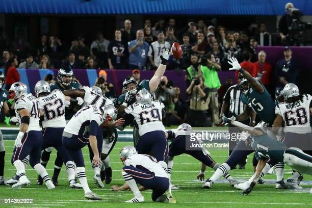 Beau Allen of the Philadelphia Eagles attempts a pass against the New England Patriots in the first half of Super Bowl LII at U.S. Bank Stadium on...