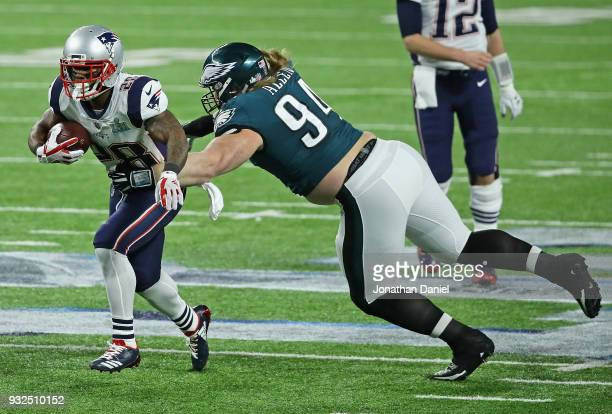 Beau Allen of the Philadelphia Eagles grabs James White of the New England Patriots during Super Bowl Lll at US Bank Stadium on February 4 2018 in...