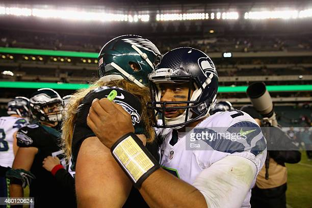 Beau Allen of the Philadelphia Eagles hugs quarterback Russell Wilson of the Seattle Seahawks after the Seahawks 24-14 win at Lincoln Financial Field...