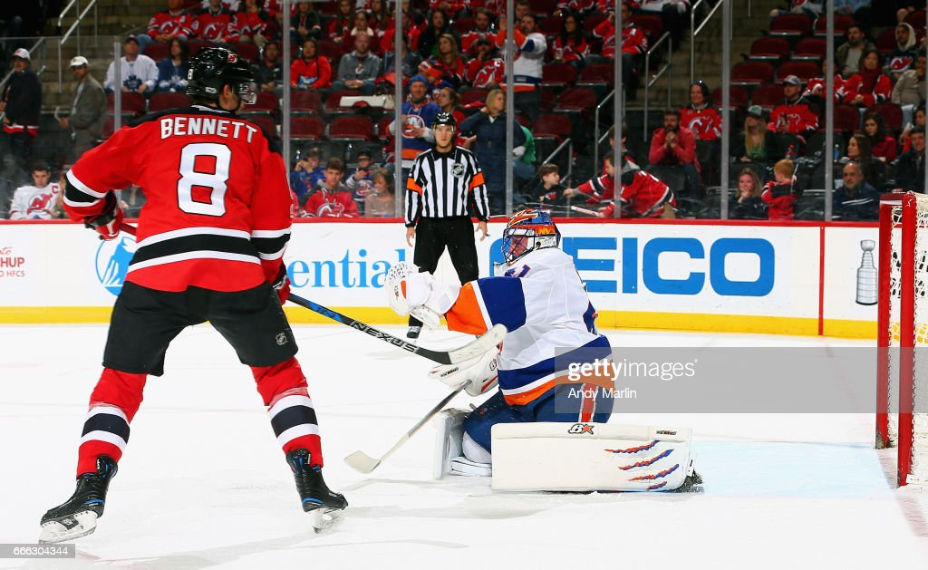 Beau Bennett #8 of the New Jersey Devils deflects the puck past Jaroslav Halak #41 of the New York Islanders for a goal during the game at Prudential Center on April 8, 2017 in Newark, New Jersey.