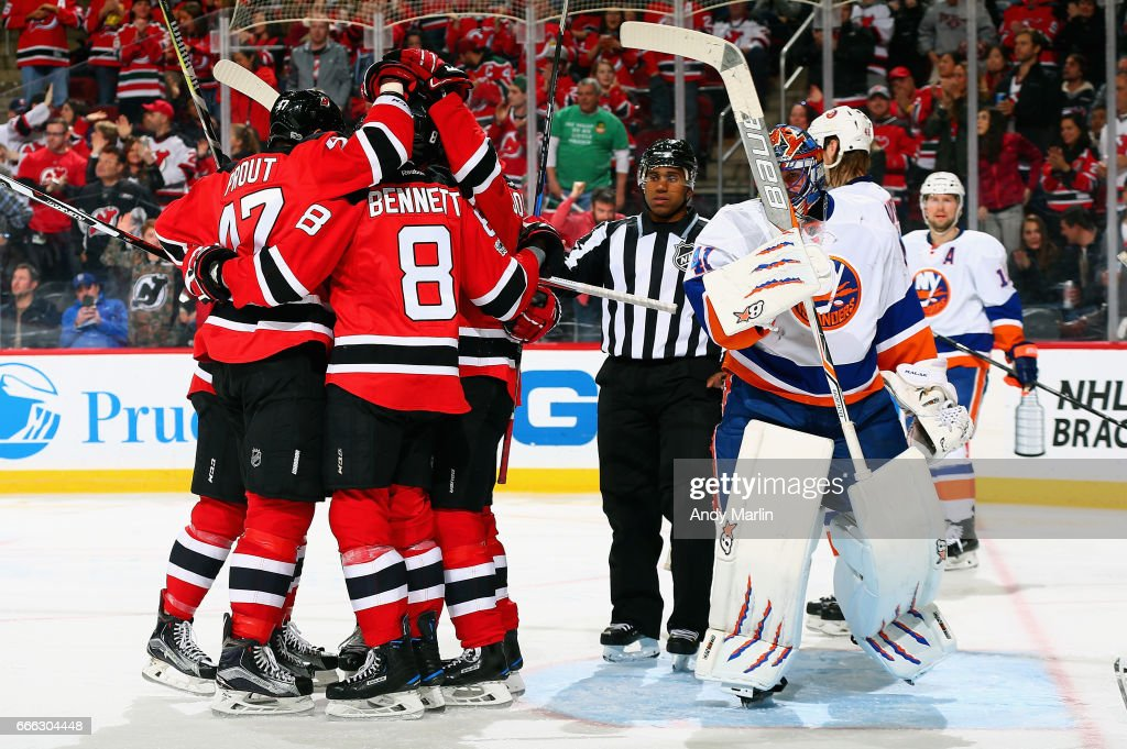 Beau Bennett #8 of the New Jersey Devils is congratulated after scoring a goal as Jaroslav Halak #41 of the New York Islanders looks away during the game at Prudential Center on April 8, 2017 in Newark, New Jersey.