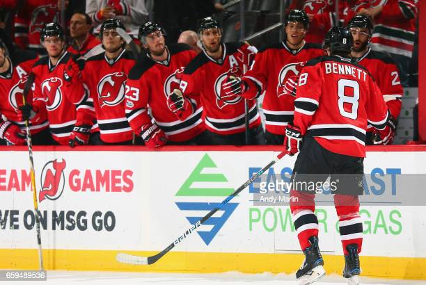 Beau Bennett of the New Jersey Devils is congratulated by his teammates after scoring a firstperiod goal against the Winnipeg Jets during the game at...