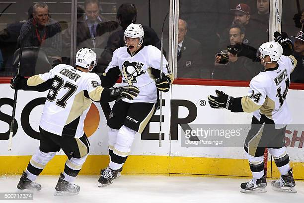 Beau Bennett of the Pittsburgh Penguins celebrates his goal against the Colorado Avalanche with Sidney Crosby and Chris Kunitz of the Pittsburgh...