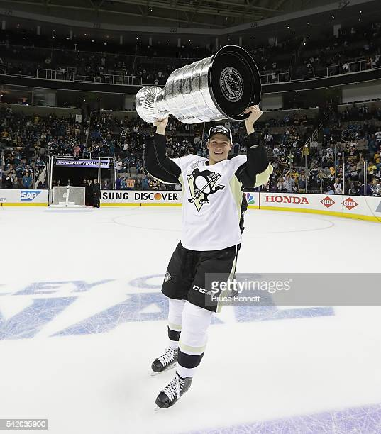 Beau Bennett of the Pittsburgh Penguins celebrates with the Stanley Cup after their 31 victory to win the Stanley Cup against the San Jose Sharks in...