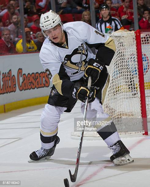 Beau Bennett of the Pittsburgh Penguins controls the puck against the Detroit Red Wings during an NHL game at Joe Louis Arena on March 26 2016 in...