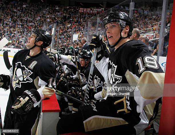 Beau Bennett of the Pittsburgh Penguins looks on from the bench during the third period against the Tampa Bay Lightning at Consol Energy Center on...