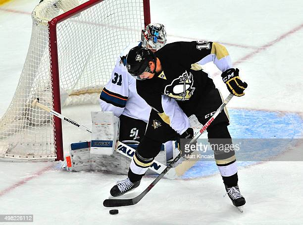 Beau Bennett of the Pittsburgh Penguins looks to put the puck in the net against the San Jose Sharks during the game at Consol Energy Center on...