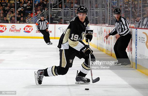 Beau Bennett of the Pittsburgh Penguins moves the puck against the Los Angeles Kings at Consol Energy Center on December 11 2015 in Pittsburgh...